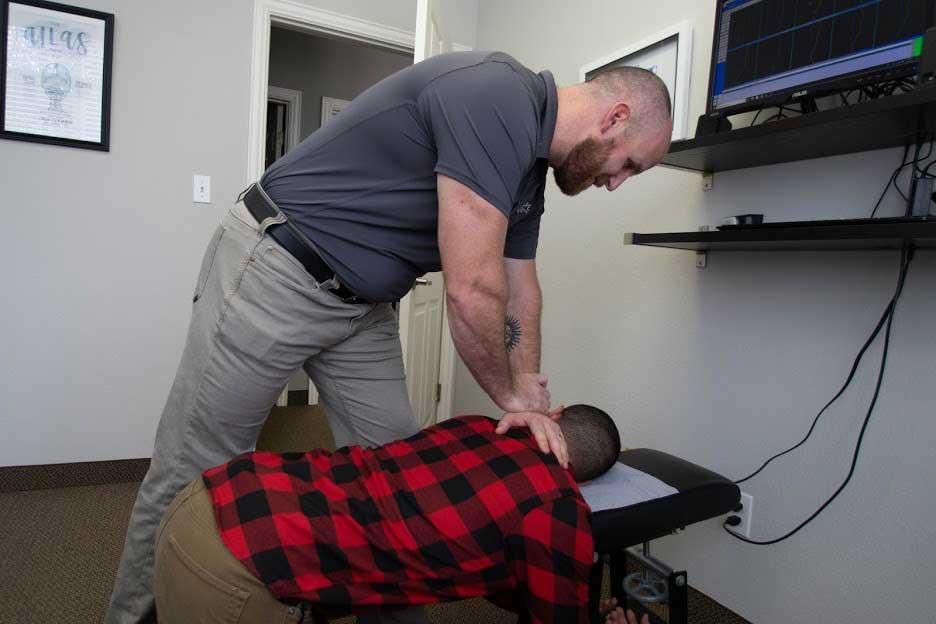 Dr. Kramer performing a chiropractic adjustment